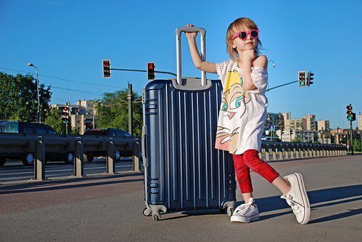 picture of girl with a suitcase ready for her trip to italy